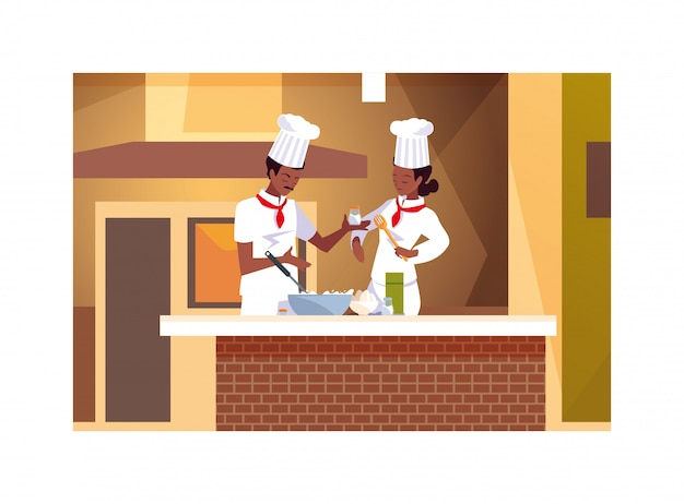 Coppia di persone in cucina, una coppia di chef con l'uniforme bianca