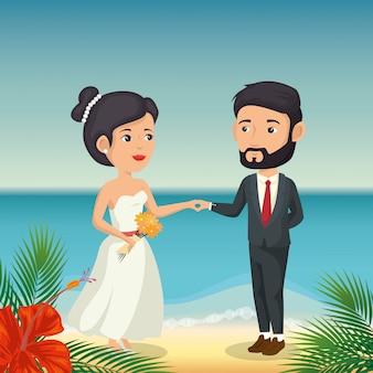 Coppia di sposi in spiaggia