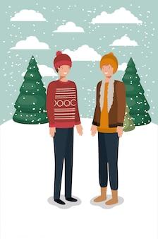 Coppia di uomini in snowscape con abiti invernali