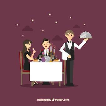 Coppia e cameriere durante la cena romantica