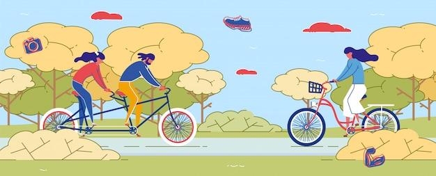 Coppia equitazione doppia bicicletta nel parco ragazza in bicicletta