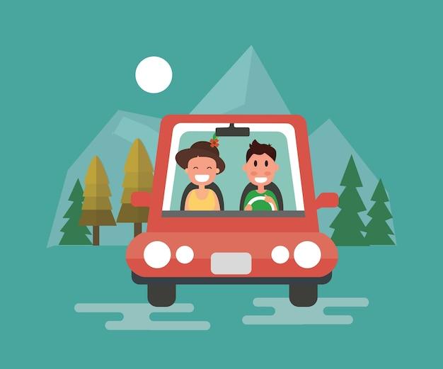 Coppia felice di guida in macchina