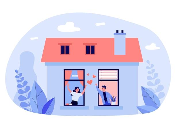 Coppia felice in piedi vicino a finestre e parlare
