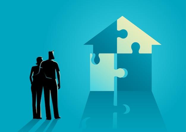 Coppia guardando casa fatta da puzzle