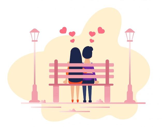 Coppia in amore seduti insieme sulla panchina del parco