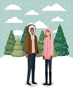 Coppia in snowscape con abiti invernali
