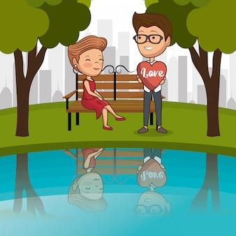 Coppia innamorata sulla sedia del parco