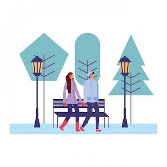 Coppia insieme nella stagione invernale del parco