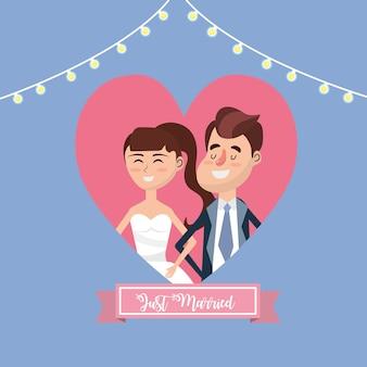 Coppia sposata all'interno del design cuore e nastro