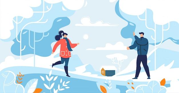 Coppie amorose felici che spendono tempo nella foresta di inverno