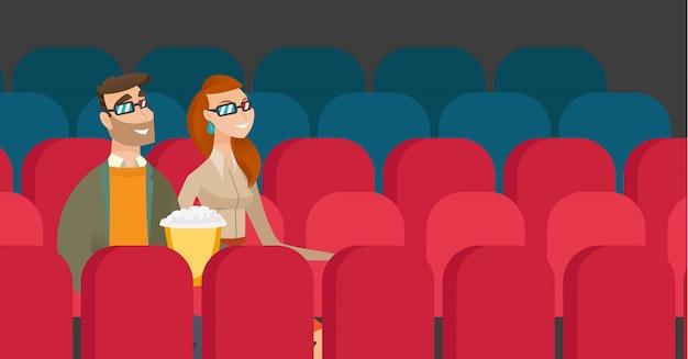 Coppie caucasiche che guardano film 3d nel cinema