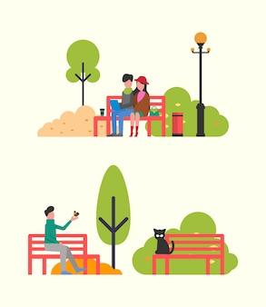 Coppie che si siedono sul banco con il taccuino, autumn park