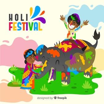 Coppie con la priorità bassa di festival di holi dell'elefante