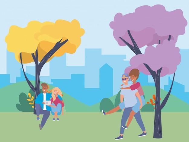Coppie di donna e uomo nel parco