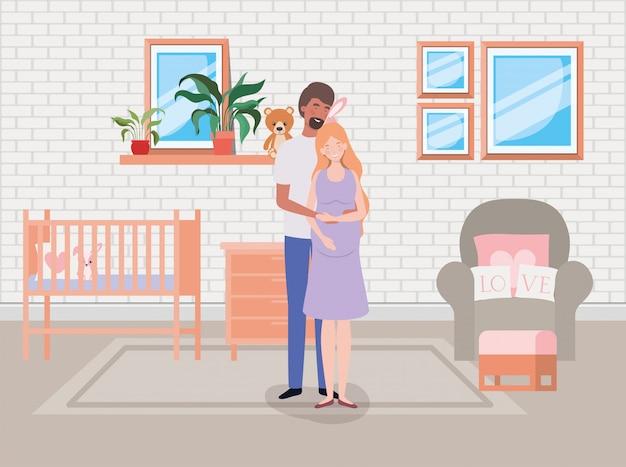 Coppie di gravidanza nella scena della stanza del bambino