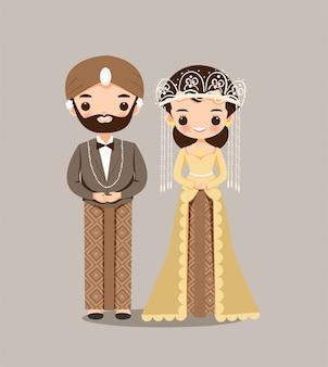 Coppie indonesiane della sposa e dello sposo per l'invito di nozze