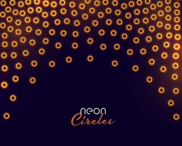 Coriandoli di cerchi dorati in stile neon incandescente