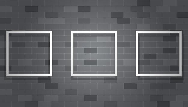 Cornice in bianco che appende sul muro di mattoni grigio
