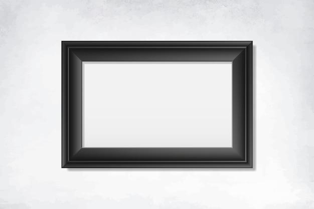 Cornice nera vuota sul muro