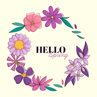 Cornice primavera disegnata a mano con foglie e fiori
