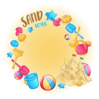 Cornice rotonda di giocattoli da spiaggia per il castello di sabbia e sabbia.