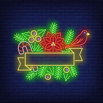 Cornice vuota del nastro, ramoscelli di abete, insegna al neon del fiore della stella di natale