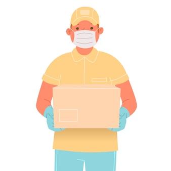 Corriere in maschera medica e guanti con un pacco. addetto al servizio di consegna durante l'epidemia di coronavirus covid-19