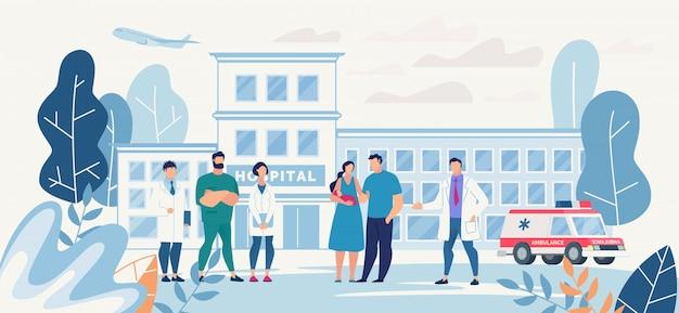 Cortile dell'ospedale con giovane famiglia e personale medico