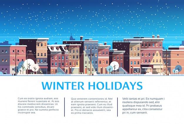 Costruzione della città case notte paesaggio invernale strada per le vacanze di natale