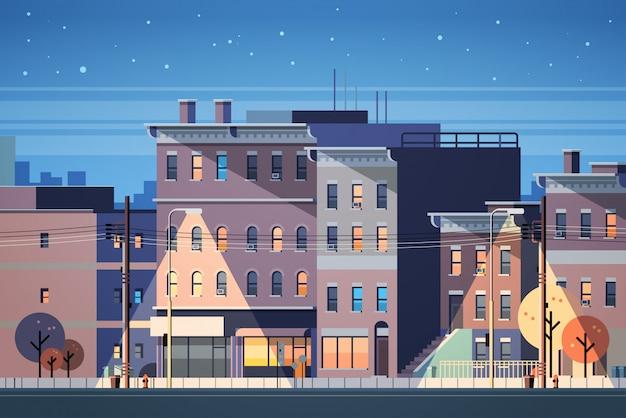 Costruzione della città case notte vista sullo sfondo dello skyline