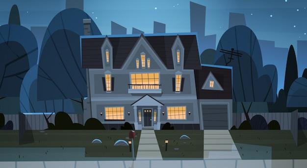 Costruzione di una casa vista notturna sobborgo della grande città