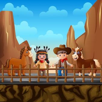 Cowboy con ragazza indiana e cavallo nel deserto