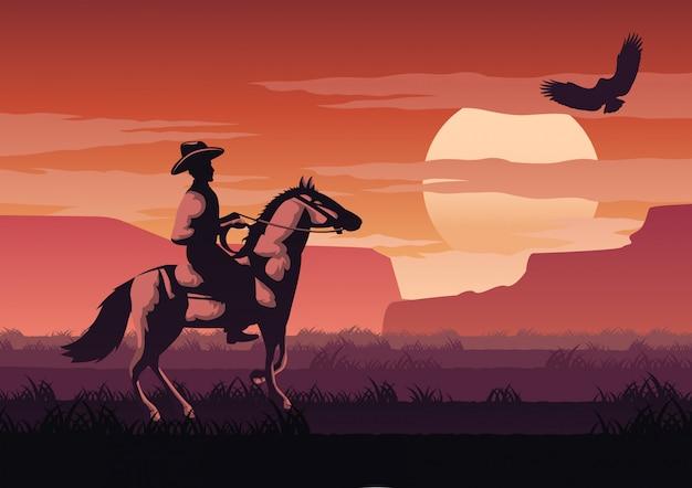 Cowboy nel campo di savannah