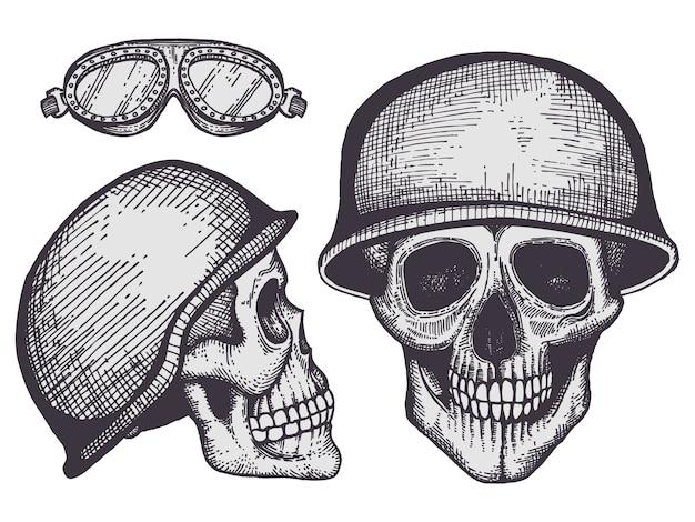 Crani umani di stile vintage motociclisti isolati su priorità bassa bianca