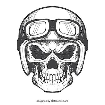 Cranio con il casco e gli occhiali disegnati a mano