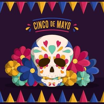 Cranio e fiori di cinco de mayo disegnati a mano