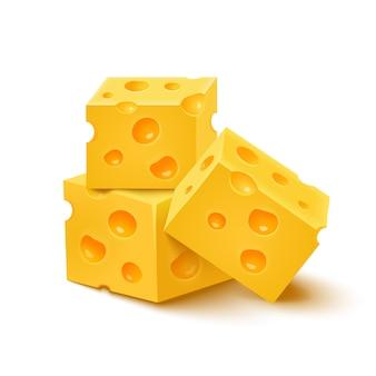 Cubi di formaggio giallo su bianco