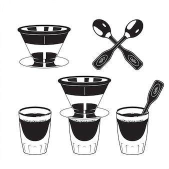 Cucchiaio filtro caffè e bicchiere di caffè espresso