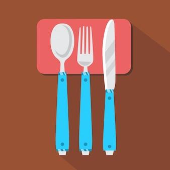 Cucchiaio, forchetta e coltello sul tavolo