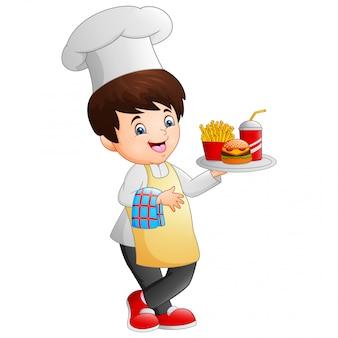 Cuoco unico del fumetto che cucina tenendo un vassoio degli alimenti a rapida preparazione