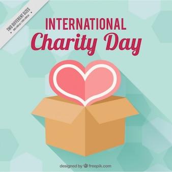 Cuore con una scatola per giornata internazionale della carità