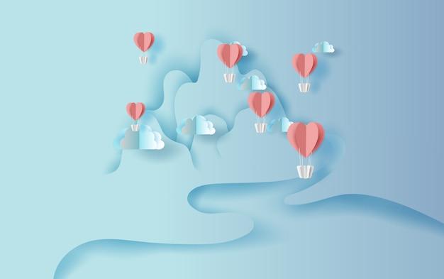 Cuore di palloncini galleggianti con paesaggio