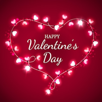 Cuore di san valentino con lampadine rosse e rosa