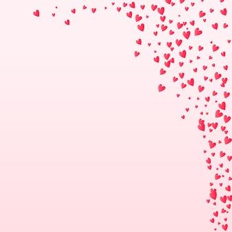 Cuori di coriandoli di san valentino che cade sullo sfondo