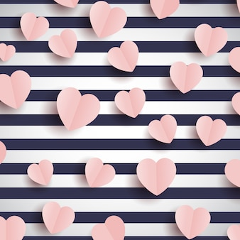 Cuori rosa su uno sfondo a strisce