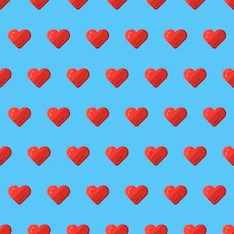 Cuori rossi su sfondo blu seamless per san valentino. fondo piatto