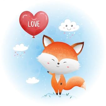 Cute baby volpe con palloncino cuore rosso.