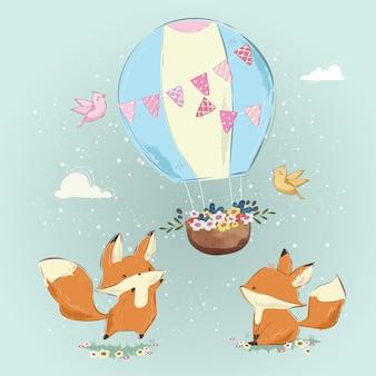 Cute foxes giocando con la mongolfiera