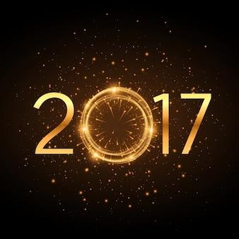 D'oro 2017 anno nuovo testo con effetto glitter incandescente e fuochi d'artificio