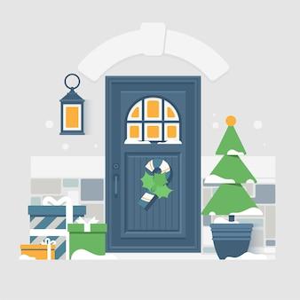 Decorazione della porta di casa per le vacanze di natale